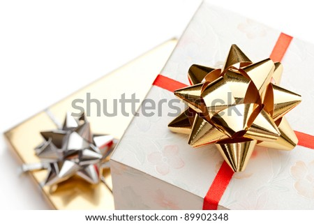 Gift boxes with bow on a white background - stock photo
