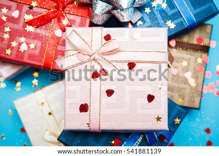 Gift boxes with bows on blue background