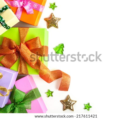 Gift boxes with bows on white background for Christmas. Top view. Copy space - stock photo