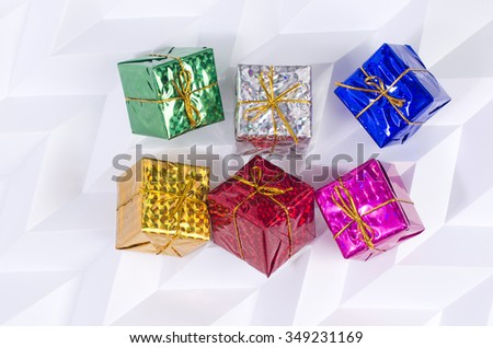 Gift boxes with brightly colored background origami - stock photo