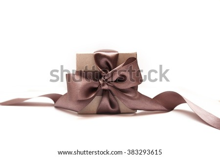 Gift boxes with brown bow on a white background - stock photo