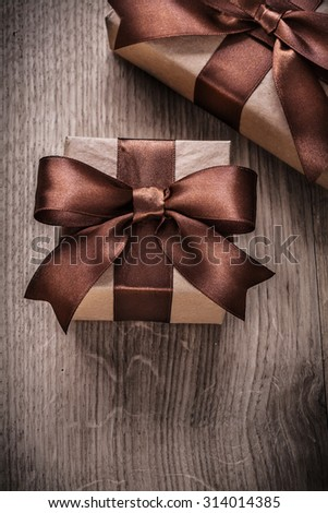 Gift boxes with brown ribbons vertical view celebration concept.