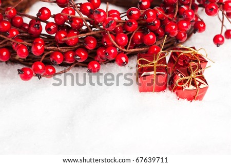 gift boxes with european holly - stock photo