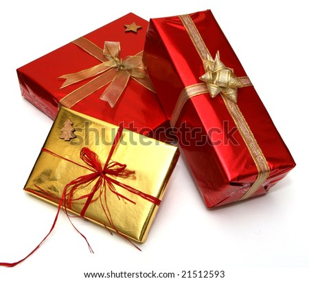 Gift boxes with golden and red ribbons isolated on white background - stock photo
