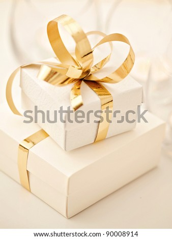 gift boxes with golden ribbon bow