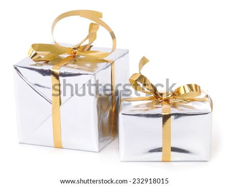 Gift boxes with golden ribbons on white background. - stock photo