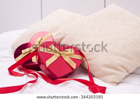 gift boxes with heart shape in the bedroom - stock photo
