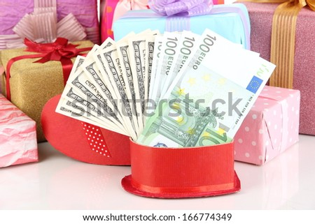 Gift boxes with money close up - stock photo