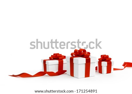 Gift boxes with red bow isolated on white background - stock photo