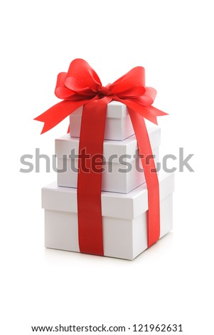 Gift boxes with red ribbon and bow on white background - stock photo