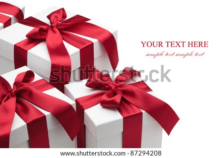 Gift boxes with red ribbons and bows isolated on the white background, clipping path included. - stock photo