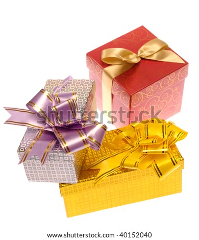 Gift boxes with ribbon on white. Is not isolated, just shot on white