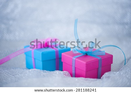 Gift boxes with ribbons on cloth background - stock photo