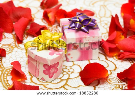 gift boxes with rose petals