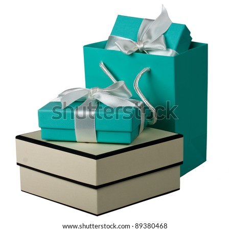 Gift boxes with white bow and gift bag on the white background - stock photo