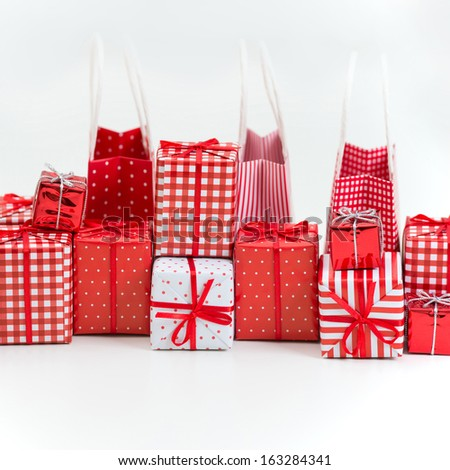 gift boxes with xmas presents wrapped in red paper with ornament on white background - Xmas Presents