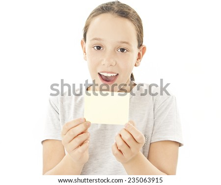 Gift card sign little girl. Excited little girl showing empty blank paper note copy space. Isolated on white background  - stock photo