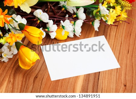 gift card with artificial flowers