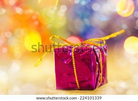 Gift Christmas box shiny lights - stock photo