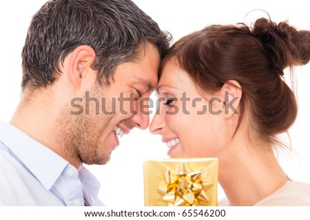 Gift couple holding present closed eyes - stock photo