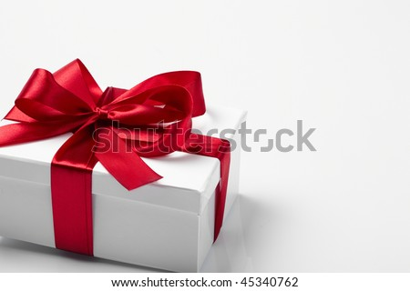 Gift decorated with a tape and a bow
