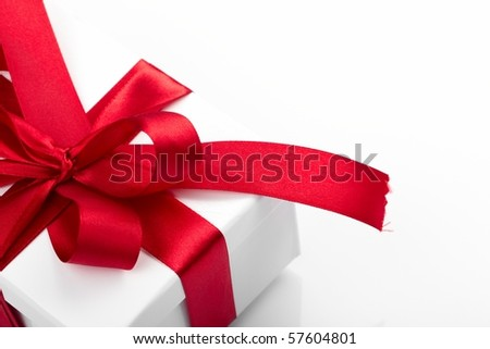 Gift decorated with a tape and a bow - stock photo