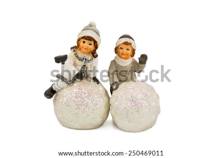 Gift figurine two children which mold snow balls isolated on a white background - stock photo