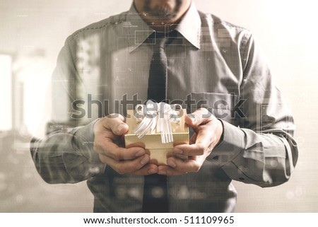 gift giving,businessman hand holding a gift box in a gesture of giving front view,filter effect,icons graphic