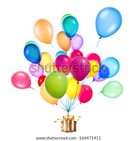 gift hanging on color balloons rising high - stock photo