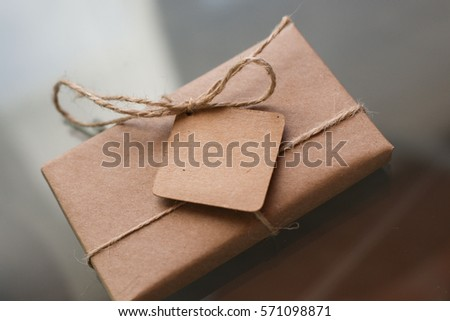 gift in a cardboard box with a label for the label
