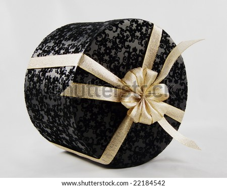 gift in black box over a white background - stock photo
