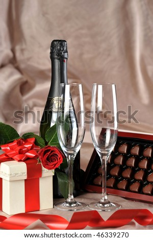 gift in box, champagne and red rose close-up
