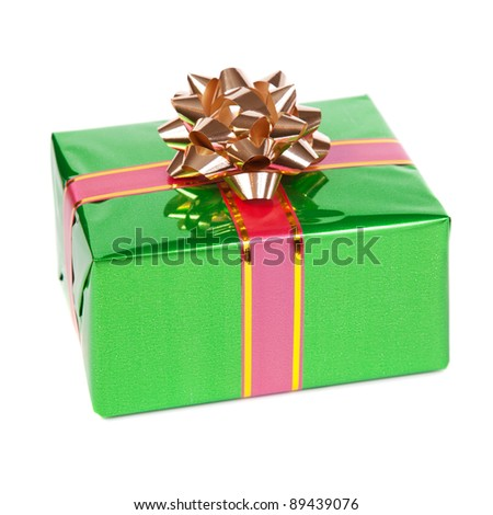 Gift in colorful package with bows. Isolated on white background - stock photo