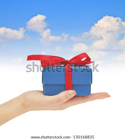 gift in hand blue summer sky - stock photo