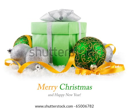 gift in snow with bow and  green balls isolated on white background - stock photo