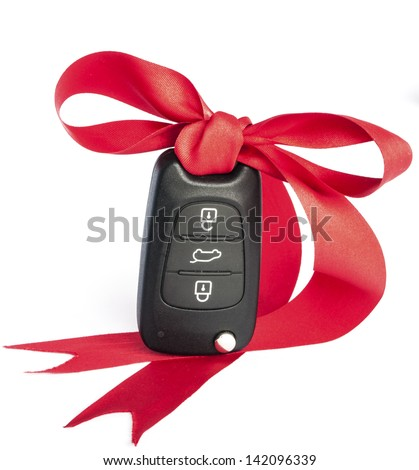 Gift key concept with red Bow on a white background. - stock photo