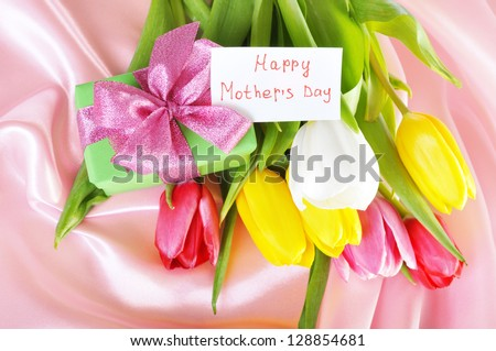 gift of flowers.Mother's day. - stock photo