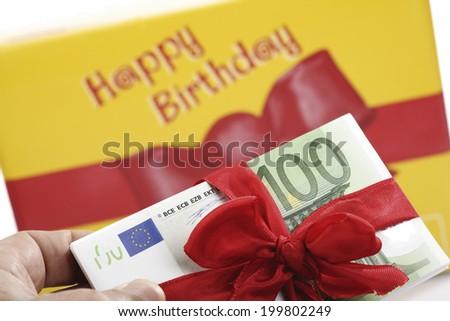 Gift of money for birthday - stock photo