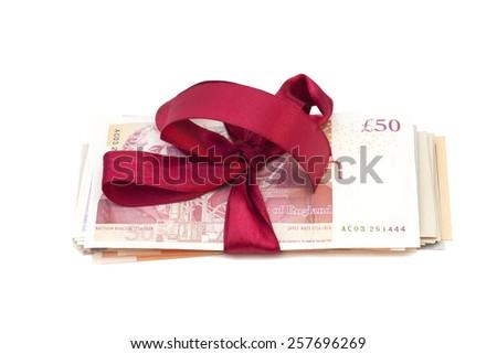 Gift of money isolated on white - stock photo