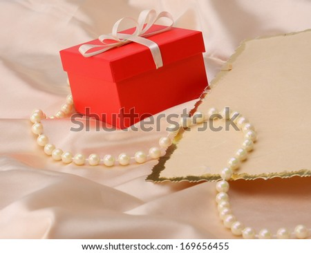 gift on red silk satin background - stock photo