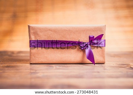 Gift on vintage background. Close up - stock photo