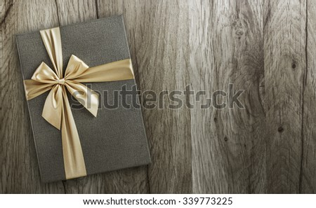 Gift on wood, top view, holiday background