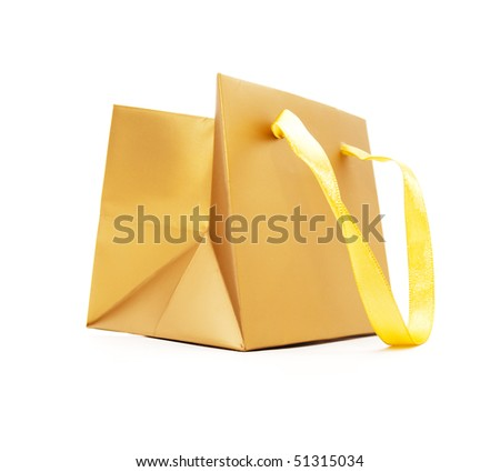 Gift package of gold colour on a white background - stock photo