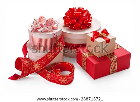 Gift packaging boxes with a bow. Merry Christmas & New Years Eve concept / studio photography of red and white box wrapping ribbon with bowknot - on white background  - stock photo