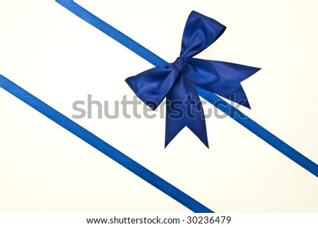 Gift packaging with blue ribbons and bow isolated on white - stock photo