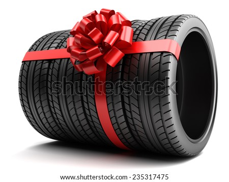 Gift set of tires wrapped ribbon and bow isolated - stock photo