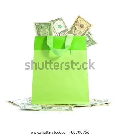Gift shopping bag packed with money - stock photo