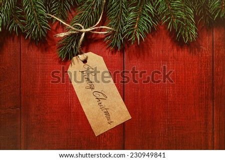 Gift tag on vintage red wood background - stock photo
