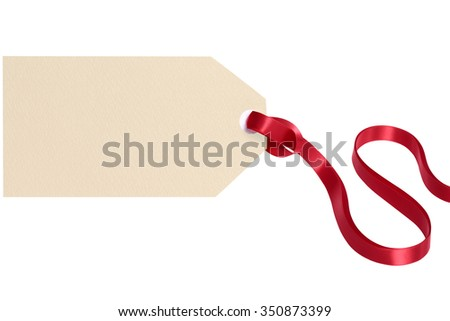 Gift tag tied with red ribbon