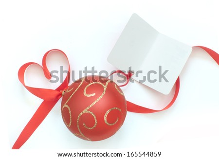 Gift tag with christmas bauble and heart shape ribbon